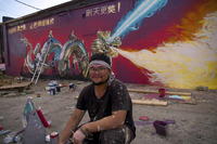 College for Creative Studies artist Anthony Lee with his mural 2017