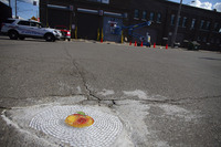 completed pothole mosaic art by Chicago-based artist Jim Bachor 2018